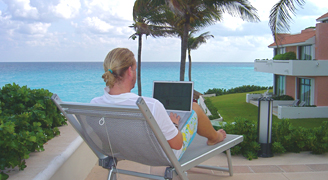 Jon on a lounge chair with his laptop